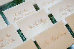 Escort cards in gold script #weddings #escortcards #blisschicago