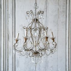 Eloquence, Inc. Antique Italian Chandelier: 1890 Antique Italian crystal chandelier, with 6 arms and old silver and gilt finish on swirled frame. Center light held by crystal babache. Please note this chandelier does not come with a chain. European canopy. 37H x 26W x D  Circa: 1890. Did i mention that I am a huge fan of crystal chandeliers? :)