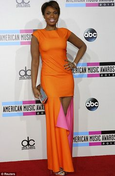 Classy and colourful: Jennifer Hudson showed off her slender figure in the orange and bright pink 'mullet' dress