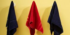 Using coat hooks is a great way to separate and organize each person's towel.