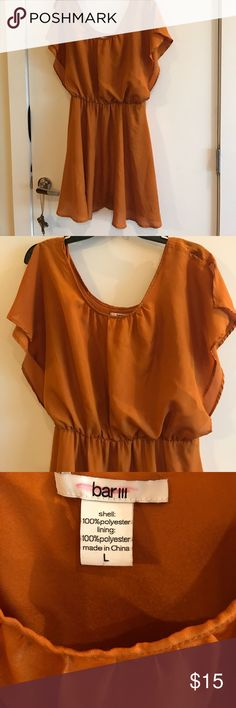 Bar III rust flutter sleeve dress Excellent condition Bar III flutter sleeve rust colored dress. Only worn once and has a very tiny pull that I showed in the picture. Cannot see it when wearing dress. Fully lined Dress Bar III Dresses
