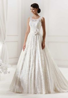The fullness of dress yet look light and the lace look is gorgeous!
