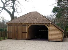 Decent sized timber car port and store with hipped, low level roof.