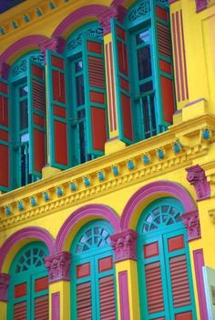 Singapore windows, yellow building with turquoise, purple and red windows Timor Oriental, Colourful Buildings, Colorful Houses, World Of Color, Mellow Yellow, Woman Painting, Restaurant Design, Windows And Doors, House Colors