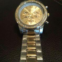 """Geneva """"Boyfriend"""" watch ' brand new! Never worn!  Gold/silver boyfriend watch- super cute- I just ended up never wearing it... Geneva Jewelry Bracelets"""
