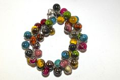 A vibrant chunky mixed bead and twisted silver plated wire bracelet. Looks fantastic and goes with literally anything.