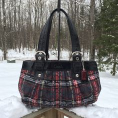 COACH Gorgeous Plaid and LEATHER Large Bag. MINT!! (bag is protected from snow)Guaranteed authentic or your money is refunded. Large Coach bag w/EXPANDING Sides. Pic #3 shows it next to a regular 12oz pop can for size comparison. Zip clos. on bag. Lots of LEATHER! Has wide leather trim band w/Coach written on the front. Also wide leather adjustable straps &Trim. Pegs on the bottom. Inside has long zip pocket & additional pockets. Bag is water/Stain resistant durable Coach material. Only used…