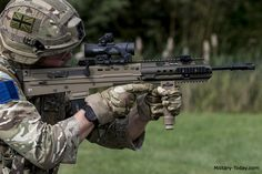 British soldier equipped with Virtus body armour and an British Armed Forces, British Soldier, British Army, Military Weapons, Military Life, Tactical Rifles, Firearms, Modern Warfare, Modern Assault