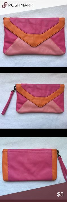 Pink & Orange Clutch Colorful clutch with magnetic closure from Target that is large enough to hold an iPhone, lipstick, and a few additional small items. There is a detachable wrist strap so it can be used as a wristlet or clutch. Bags Clutches & Wristlets