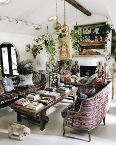 Summer style!! Elegant Bohemian Chic!! Look at the classic white walls and floor and ceiling!! And then the mix of patterns, textiles, plants - to create a very welcoming living room!