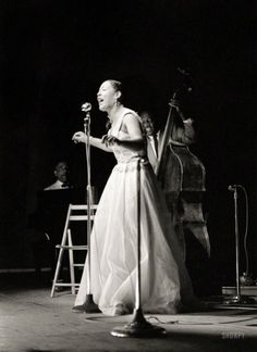 Billie Holiday, with Teddy Wilson at the piano and Milt Hinton on bass, at the Newport Jazz Festival in July 1954, five years from the close of her career and the end of her life.  https://www.aphroditesvisionstore.com