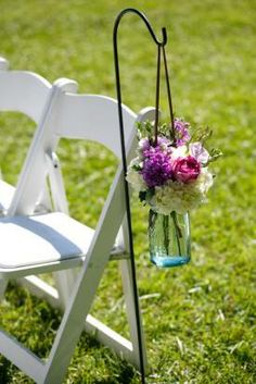 Down the aisle: we will have 10 shepherds hooks (5 on each side of the aisle) holding either mason jars or milk jars.  A variety of a couple a few of flowers (daisy/baby breaths/garden rose. open to suggestions) in whites/brighter pinks and purples - we want these to be brighter than the centerpiece flowers).               Colours we think may be nice down the aisle (whites, greens, purples and brighter pinks)  with a little less in each jar / not so full.