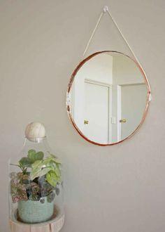Edge a simple round mirror in copper tape.