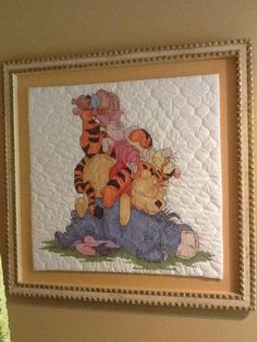 Framed cross stitch quilt of Winnie the Pooh