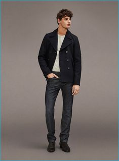 American model Jacob Morton sports a short peacoat with denim jeans from Frame Denim.