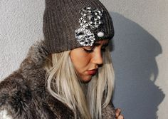 add a brooch to your knit beanie. Did this before and I always get so many compliments. I also added a feather.