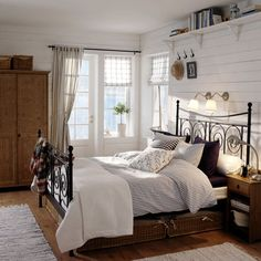 I want a shelf over my bed like these.  Not as high up as this one.  Black brackets, distressed wood stained shelf and two rows of shelves.