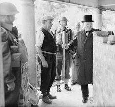 The Prime Minister Winston Churchill helps to build a pillbox at Canford Cliffs, Poole, England, during a visit to Southern Command on 17 July 1940.