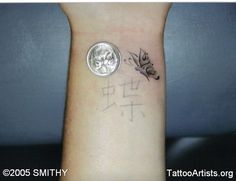 I want this but with some blue details and positioned closer to the base of my thumb