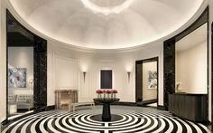 STATURE IN THE SKY in @ NYC  Residential Lobby Private residential lobby with labyrinth-patterned stone floor, white lacquer walls, silver leaf rotunda ceiling, and fireplace.