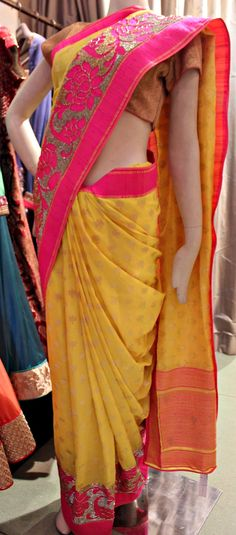 Brighter than sunshine yellow contrasted with heavenly pink equals an out of this world saree!