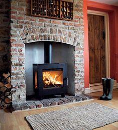 Wood Burning Stove - brick chimney with brick hearth Wood Burner Fireplace, Fireplace Hearth, Fireplace Design, Wood Stove Wall, Two Sided Fireplace, Country Fireplace, Red Brick Fireplaces, Brick Hearth, Modern Fireplaces