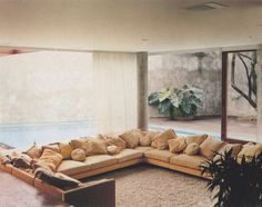love this couch and its relation to the window...isay weinfeld