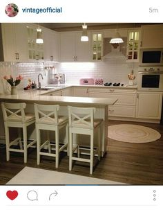 White vintage girly kitchen. I love the pop of pink!
