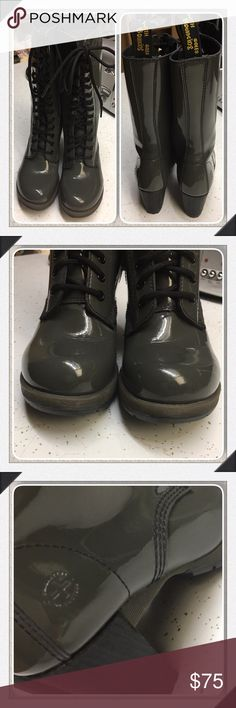 Doc Martens Dee Diva 14 Eye Heel Grey Boots US 7 Dr. Martens Women's Dee Diva Collection in Gray (Grey) Patent Leather Size US 7 / EU 38 / UK 5 • 14-eye lace closure • AirWair back tab • 1'' platform height • 12'' boot shaft height • 3'' heel height • Cushioned footbed • Full inside zip entry • Patent leather upper • Two-tone lugged rubber sole • Vertical stacked heel Good condition however please use your own judgement and review photos. If there is another view or photo you would like…
