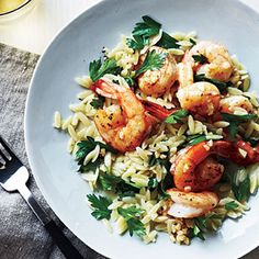 Indulge in the flavor of the Mediterranean with plump shrimp tossed with lemon and pepper and served over a bed of orzo.