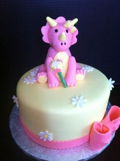 Baby dinosaur cake By nicunurse on CakeCentral.com.  Cute girly dino cakes get my heart everytime.