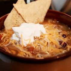 Chicken Tortilla Soup (Crock Pot).  I didn't add water, just the chicken stock, instead of adding each spice individually, I just added a packet of taco seasoning, I used fresh cilantro and I added lime right at the end before I served it, oh and I used peppered jack cheese instead of a Mexican blend cheese.  The whole family loved it!