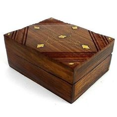 Delicate+vines+and+leaves+of+inlaid+brass+accent+this+carved+box+with+hinged+lid,+handmade+by+Indian+artisans.+The+box+is+4+inches+wide+by+5+inches+long,+and+2+inches+tall.  Meet+the+Artisans  Noahs+Ark  An+NGO,+Noah's+Ark+Handicrafts+&+Artisan+Welfare+Society,+was+created+in+2000+to+advanc...