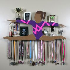 Change to a dancer doing a firebird and add hooks on the bottom :) Gymnastics Videos, Gymnastics Team, Cheerleading, Trophy Display, Award Display, Gymnastics Bedroom, Gymnastics Equipment, Gym Room, Ballerina