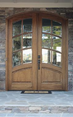 Solid wood double door from http://simplestylings.com/home-of-the-month-lake-house-reveal/
