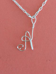 So cute!  Single Initial  Necklace by TwoCraftingChicks on Etsy