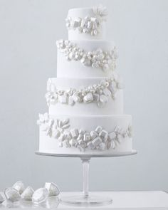 This fondant-covered treat dripping in sugar gemstones is the crown jewel of cakes. To make it, contributing editor Wendy Kromer, of Wendy Kromer Confections in Sandusky, Ohio, sprayed the baubles with edible pearl paint and used royal icing to attach them necklace-style around the tiers. For favors that continue the precious-stone theme, fill diamond-shaped containers with rock candy.