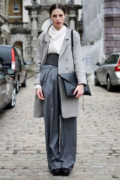 What: Varying shades of gray break up the levels of this tailored ensemble.    Wear: H coat, Margiela pants, Weekday belt, Pap Accessories bag