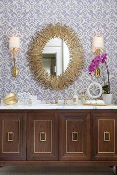 Artistic Designs for Living - Fab bathroom with lilac floral wallpaper, wood vanity & brass accents