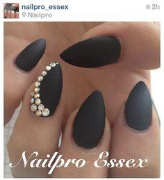 Matte black nails. NOT the almond shape.   Nails Número Uno