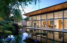 sustainable-home-manmade-pond-lush-landscaping-3-social.jpg