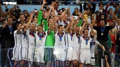 Philipp Lahm of Germany lifts up the World Cup trophy with his team-mates