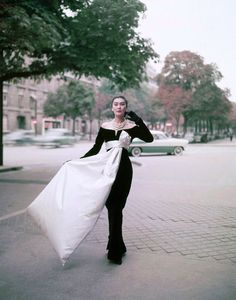 1955-56 - Alla wearing the iconic evening gown designed by Yves Saint Laurent for Christian Dior, Paris