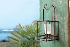 Framework Hanging Candle Lantern - Classic, bronze-finished metal lantern adds a dramatic focal point to any wall. Add decorative accents to the base to customize the look for each season. Includes one tall frosted cup for use with votives or tealights, or use alone with a round pillar. All candles sold separately. Includes wall bracket. Also can be used tabletop. : Shop online at www.PartyLite.biz/NikkiHendrix