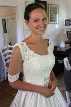 Adding a lace overlay with sleeves to a strapless wedding gown