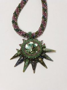 Matte Olive Rainbow and Matte Amethyst Kumihimo Necklace with 27mm Ernite Rivoli and Unicorne Spike Beads by Tina at GrnEydDesigns