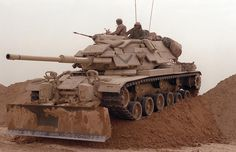Marines from Company D, 2nd Tank Battalion, drive their M60A1 main battle tank during a breach exercise