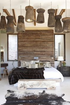 The Olive Exclusive Boutique Hotel; wood headboard, add embellishment, light fixtures attached...