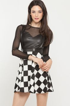 Checkered skirt with two vegan leather criss crossed straps can go with any favorite flats or pumps also can be worn with any crop top or body suit. Check it out on www.cicihot.com #CiCihot #fashion #checkeredprint #veganleather #croptop #mesh #longsleeve #springstyle #springfashion #edgy #music #rockinpsired #chic