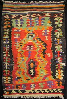 An extraordinary primitive and expressionistic yoruk prayer kilim from Cal in Western Anatolia. The bright colours and spontaneous weaving belie the fact that this kilim has some age to it.